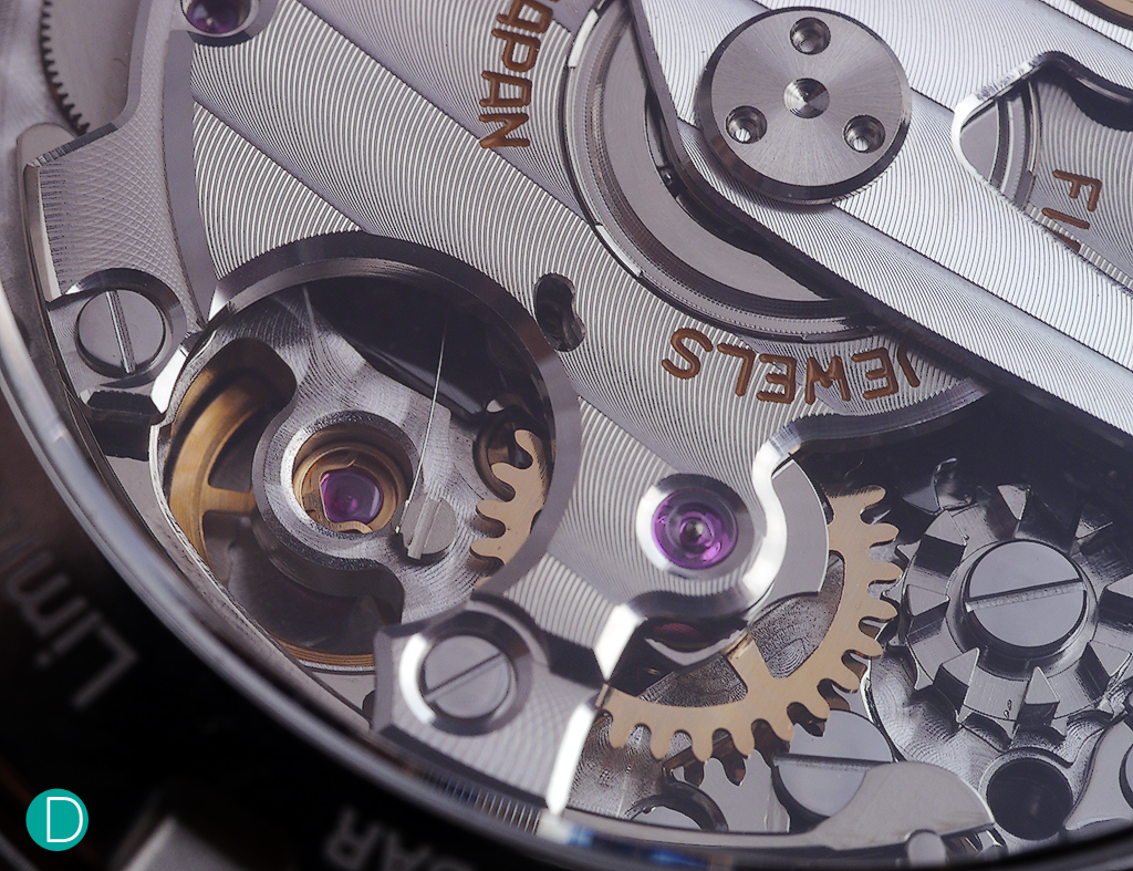 The glide wheel and on its right, the fourth wheel, on which the continuous seconds hand is affixed to its arbor on the dial side.