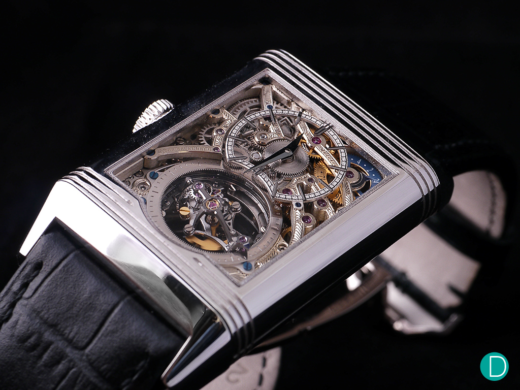 The back dial is skeletonized to show more of the movement. The dial proper itself is heavily skeletonized and a am/pm indicator is visible at 2 o'clock.