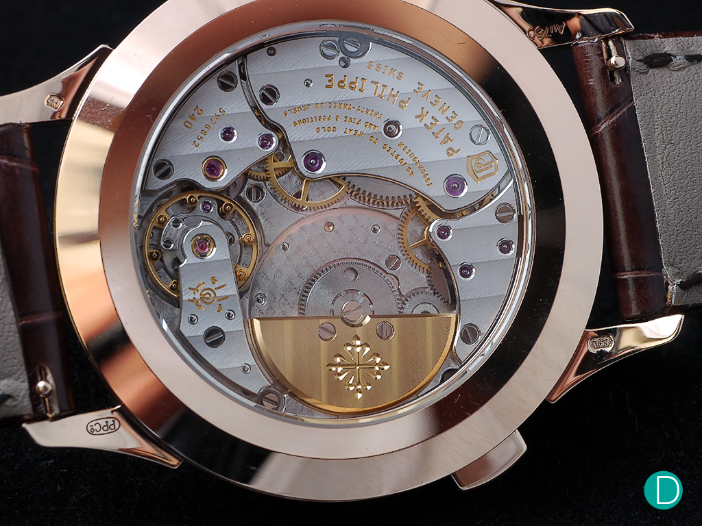 Patek Caliber 240 HU. HU stands forHeure Universelle, meaning universal time.