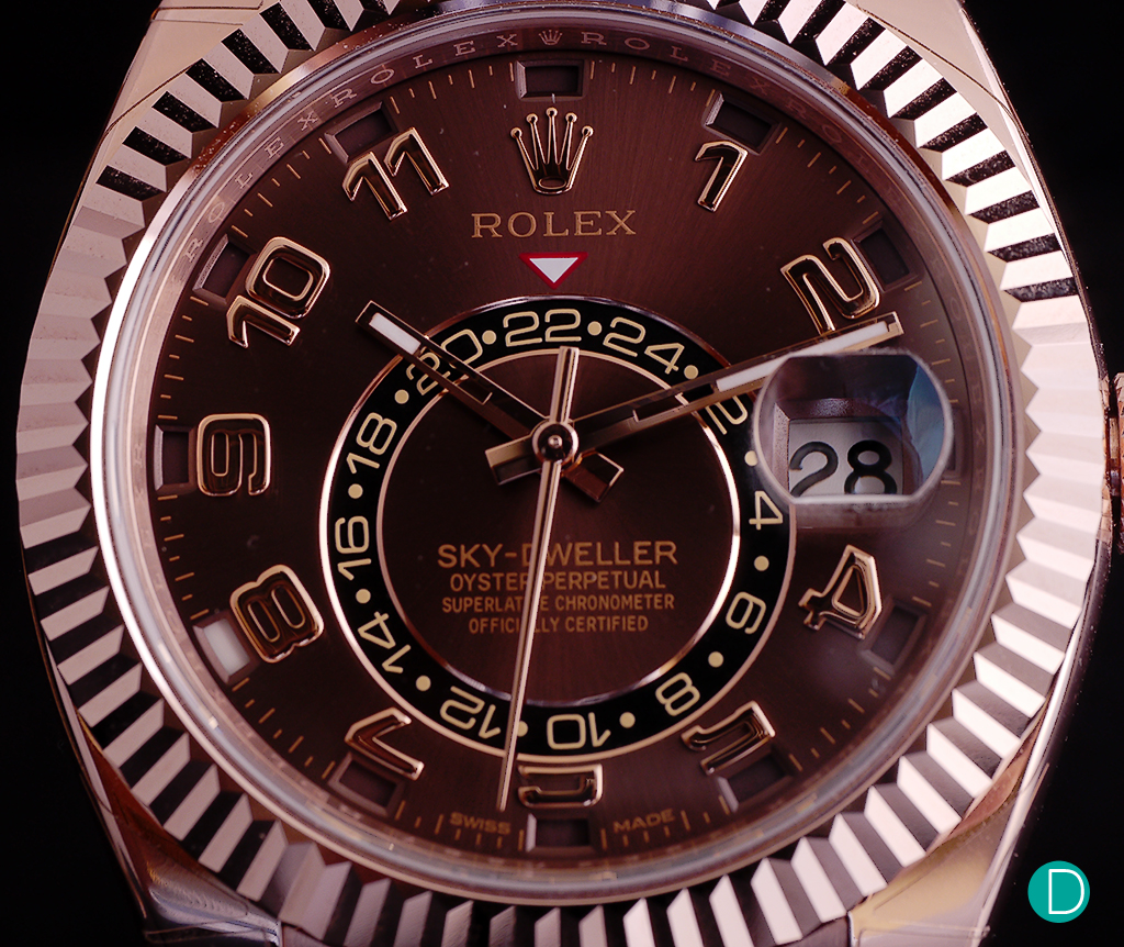 The chocolate dial is quite beautiful, but on the photograph, as it reflects light from different angles, it takes on a different colour.